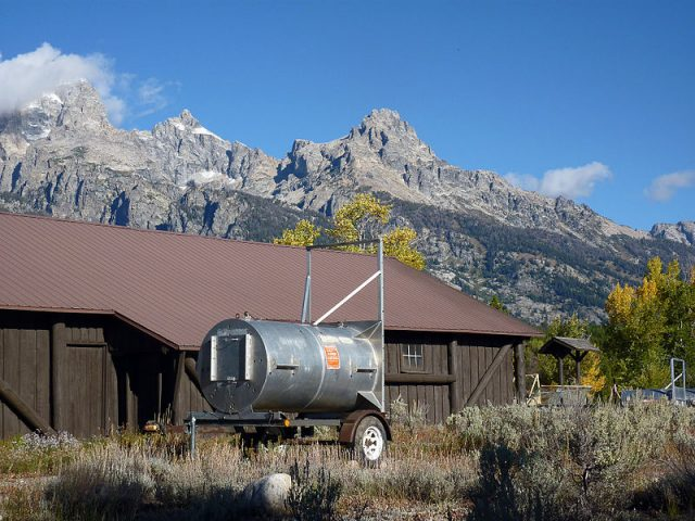 Drum or barrel trap, used to safely relocate bears, adjacent to a building in Grand Teton National Park in Wyoming, United States. Photo credit