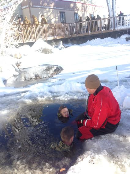 Two American marines participating in an immersion hypothermia exercise.