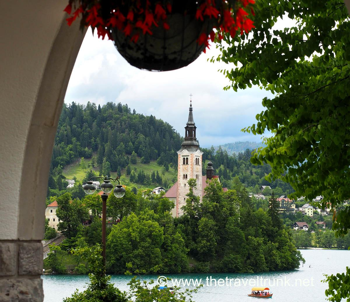 The island and Church of the Assumption of Maria in the middle of Lake Bled as viewed from the former residence of President Tito.