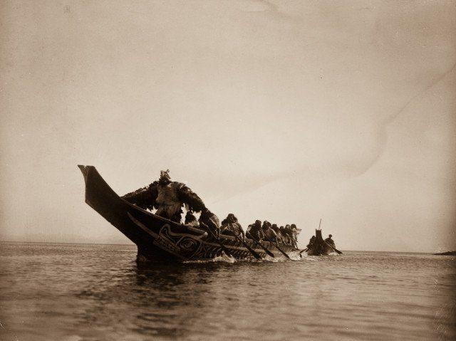 Kwakiutl people in canoes in British Columbia. 1914