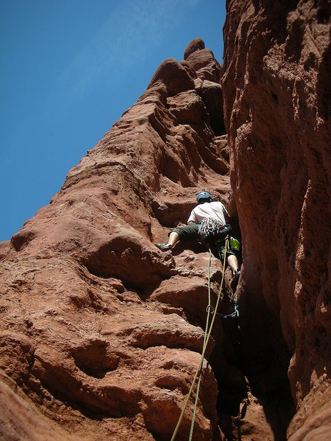Me climbing the second pitch – Author: Tristan Higbee – CC BY 2.0