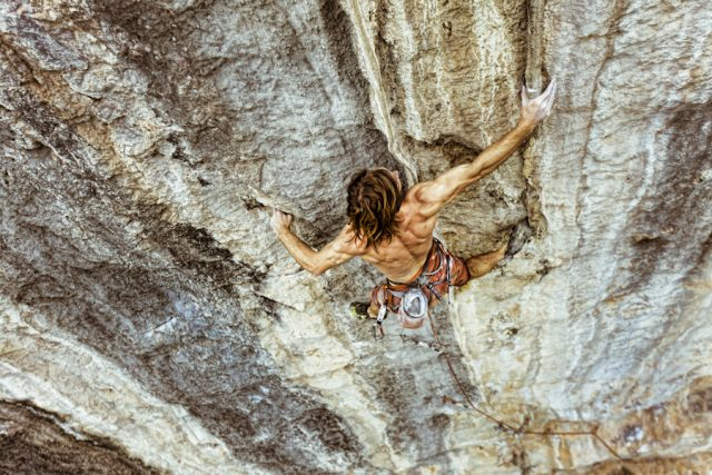 "Chris Sharma on the first ascent of ""Spicy Noodle"", White Mountain, Yangshuo, China. At 5.14c, it is currently the hardest route in China."