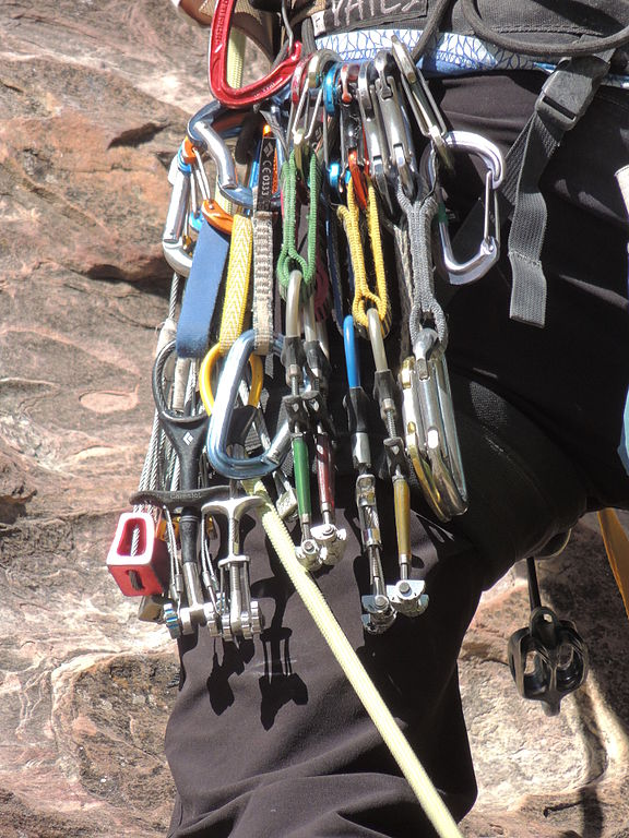 Climbing gear racked up on a harness