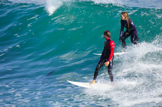 "The number one rule of surfing is to not ""drop-in"" on other surfers like this woman is."