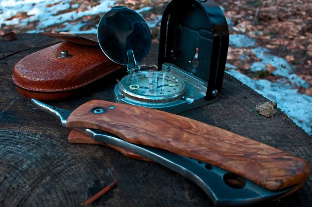 Folding knife and compass