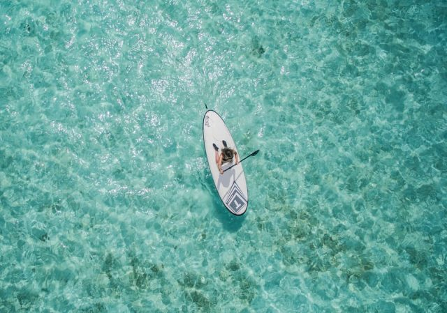 Paddle boarding is perfect in calm waters.