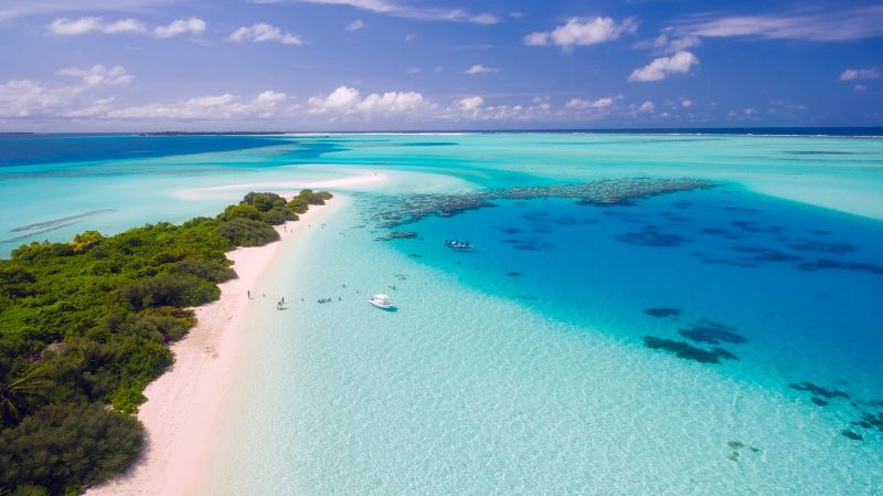 The island nation of the Maldives boasts numerous shallow lagoons, white sandy beaches, and coral reefs