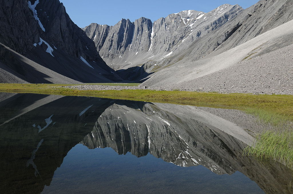Small tarn in a hidden valley in the Itkillik Preserve, sometimes called the Yosemite of the Arctic. Gates of the Arctic National Park and Preserve