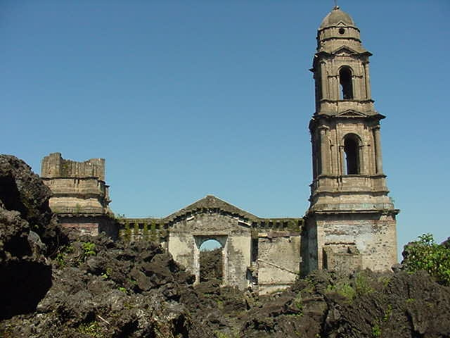 Remnants of the main church of San Juan Parangaricutiro, Mexico. The village was covered in lava and destroyed when the volcano Parícutin erupted in 1943–1952 – Author: ser:Sparksmex