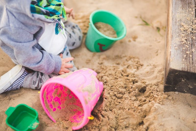 Playing in sand is a fun activity for children