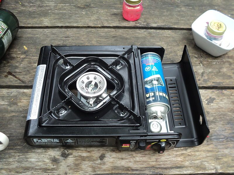 This is the type of camp stove I have in my car. Works great as long as I don't run out of gas.