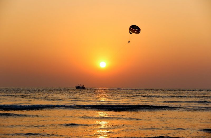 Parasailing on a sunset