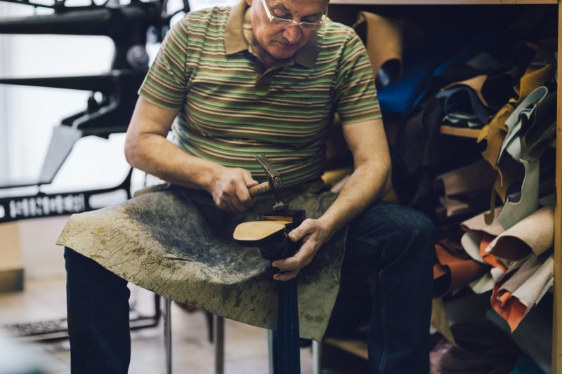 The cobbler would build up the sole and then the heel in layers, starting with an edging around the perimeter of the shoe