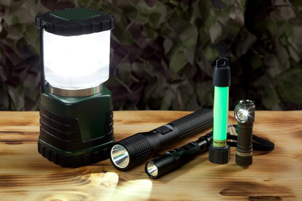 Lanterns, LED flashlights, and glow sticks are must-have items for any camping trip