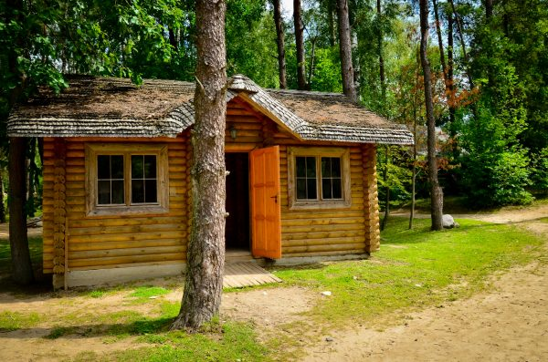 A little rustic log cabin in the woods on a sunny day is an idyllic experience that many people want to have.