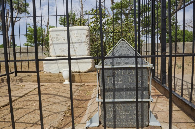 Fort Sumner, New Mexico, United States – June 4, 2012. William H. Bonney aka Billy the Kid's grave in Old Fort Sumner post cemetery in New Mexico. A prominent figure in the American Wild West, he captured notoriety as an outlaw in 1881 when a bounty was placed on his head.