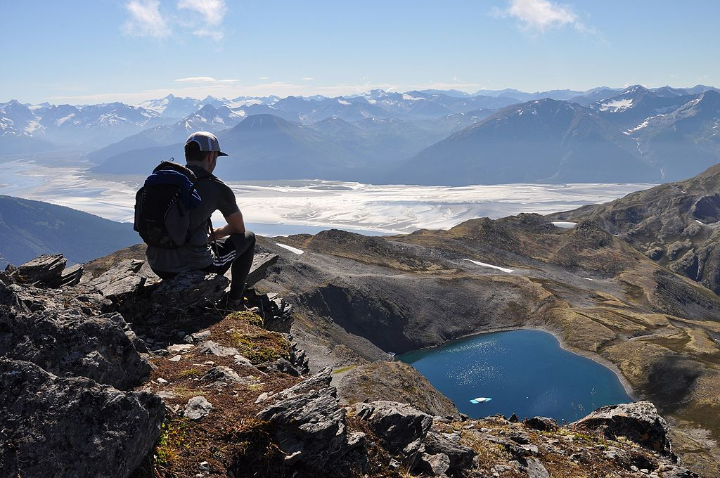 A hiker on the summit of Gentoo Peak, in Alaska's Chugach State Park - Author: Paxson Woelber - CC BY-SA 4.0