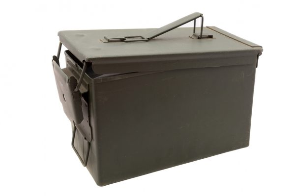 A green metal ammo box like this is a great choice for a survival cache container because it can hold a lot of items and resist moisture and other elements when buried