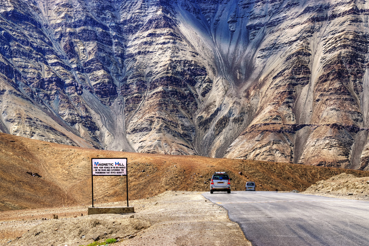 "A gravity hill where slow speed cars are drawn against gravity is famously known as ""Magnetic Hill"" , a natural wonder at Leh, Ladakh, Jammu and Kashmir, India"