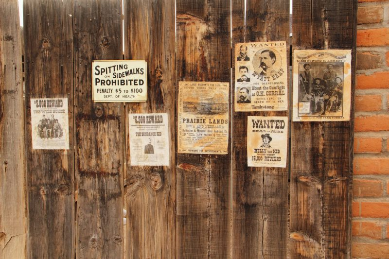 Tucson, Arizona, United States – November 21, 2014: A number of vintage wanted posters of outlaws including Wyatt Earp, Sundance, the Kid, The James Gang, and The Wild Bunch.
