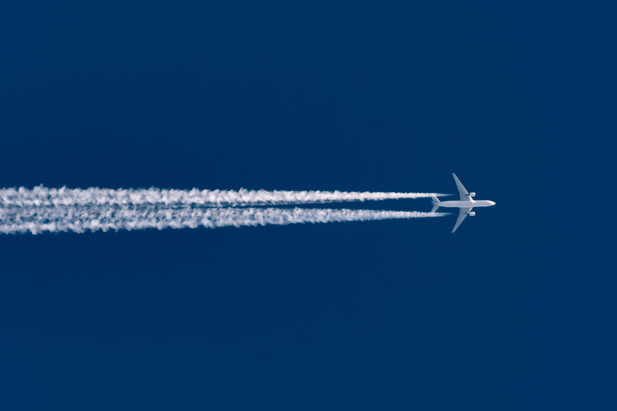 Leaving contrail trace on a clear high blue sky
