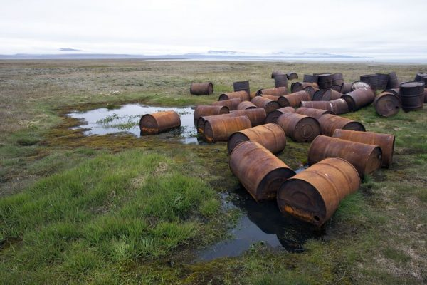 Barrels of petrol abandoned by the Russian army after the cold war. (Photo by Sylvain CORDIER/Gamma-Rapho via Getty Images)