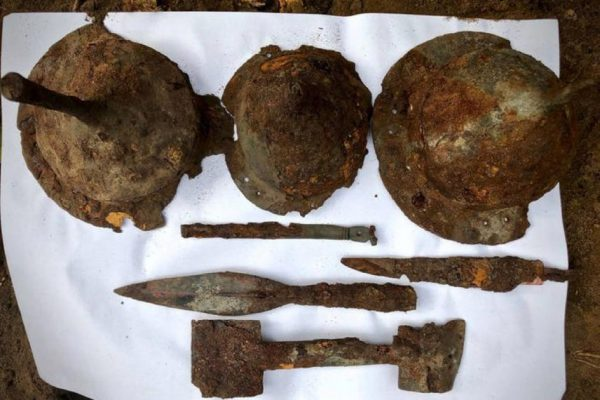 Spearheads, helmets and other items found at the Germanic warriors burial site. Tempelburg Historical and Cultural Association and Kostrzyn Fortress Museum