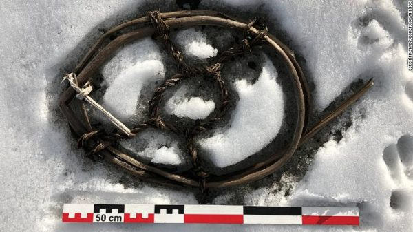 Researchers are intrigued by this horse shoe. PHOTOGRAPH BY ESPEN FINSTAD, SECRETS OF THE ICE