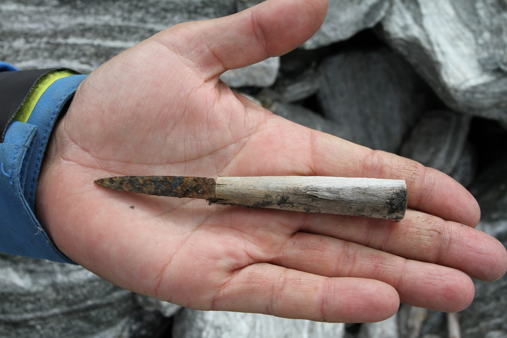 Knife: A small iron knife with a birchwood handle, found just below the pass area at Lendbreen. Radiocarbon-dated to the 11th Century AD. Photo: Espen Finstad, secretsoftheice.com.