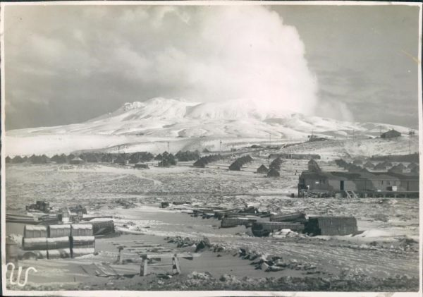 Houses line up in rows before the mountain at Adak Army Base and Naval Operating Base.