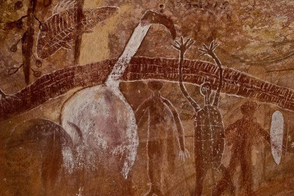 Panel of ancient rock art paintings of a rainbow serpent, white Ibis and human figures , at the Quinkan rock art site called, White Ibis Gallery, Quinkan Cave near Laura, Cape York, Queenland, Australia