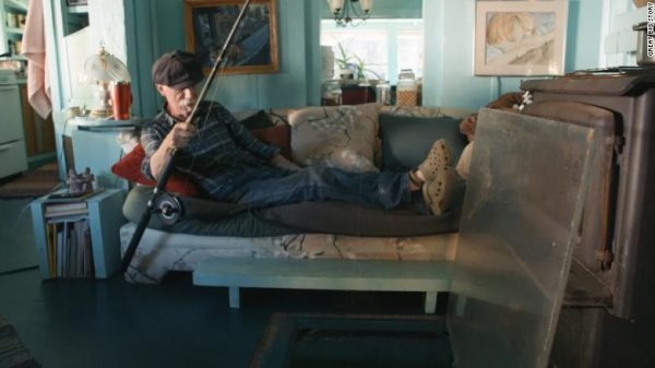 With a hole in the floor Wayne can even fish from the comfort of his sofa! Credit: Catherine King and Wayne Adams